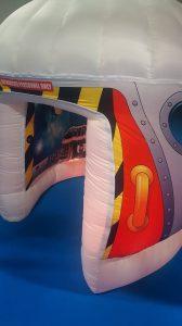 A sensory pod with awesome lights made to look like a rocket.